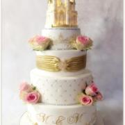 Wedding cake chateau en or et blanc